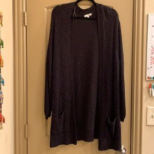 Black oversized cardigan with front pockets